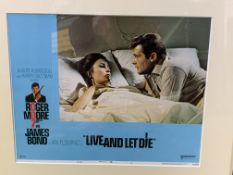 2 Framed and glazed prints of film posters: 'Live and Let Die' and 'The Spy Who Loved Me'
