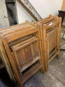 Twelve wooden folding chairs