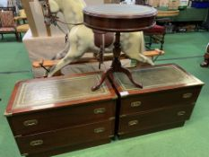 Pair of brass bound mahogany chests of two drawers; together with a mahogany drum table