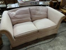 Cream and pink upholstered two seat sofa