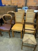 Seven various chairs.