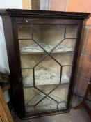 Mahogany wall-hanging corner cabinet with three shelves and glazed door with glazing bars