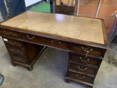 Mahogany pedestal desk with brown skiver