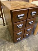 Two four drawer index card filing cabinets