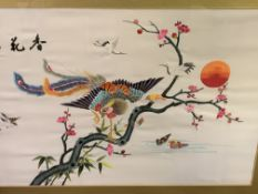 Framed and glazed Oriental embroidery on silk, with a Thai watercolour.