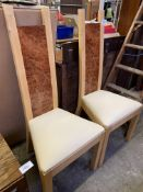 Two contemporary high back dining chairs