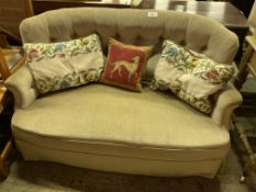 Pale green buttoned back curved two seat sofa