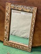 Bevelled edge mirror with ornate wood and bone inlaid frame