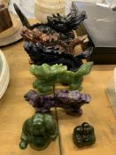Five carved stone Chinese dragon figures, an onyx lidded pot and two laughing Buddha figures.