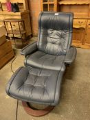 Dark blue leather upholstered reclining chair with footstool