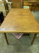 Teak extendable dining table.