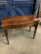 Mahogany serpentine fronted, fold over top, gate leg tea table, on tapered legs. This item carries