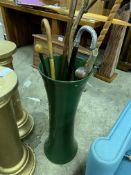Tall ceramic vase with eight walking sticks