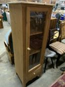 Pine cabinet with glazed door and drawer beneath