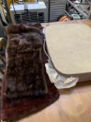 Two fur stoles and a small suitcase