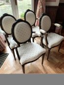 Set of four carved and upholstered elbow chairs