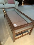 Rectangular display/coffee table with bevelled edge glass and rising lid