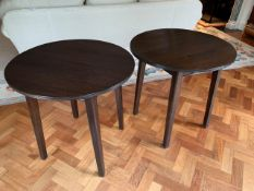 Two dark brown circular occasional tables on four block legs