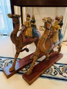 Pair of Indian carved wooden camels with riders