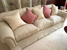 Cream cord effect upholstered three seat sofa, with feather filled cushions