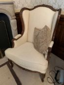 Carved and cream upholstered show wood French style armchair