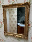 Gilt wood frame bevelled edge wall mirror