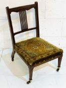 Edwardian mahogany nursing chair