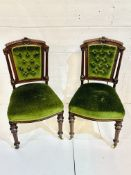 A pair of mahogany framed column sided button back dining chairs.