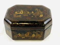 Black lacquered octagonal box with Chinese scenes to lid and panels