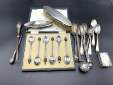 A quantity of hallmarked silver spoons and other items