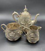 Early 20th Century Asian silver teapot, sugar bowl and mask jug