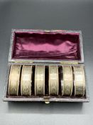 Six Victorian finely decorated napkin rings