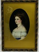 Gilt framed and glazed oil on board portrait of a lady in an oval mount