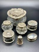 Six silver lidded glass pots
