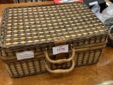 Wicker picnic basket complete with plastic accessories