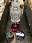 Two crystal decanters and three paperweights