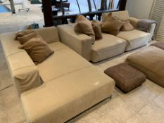 Light brown floor cushion and two rattan stools.