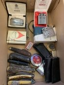 Collection of eight penknives and seven cigarette lighters