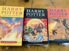 Two Harry Potter first editions, and another Harry Potter book