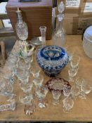 Quantity of vintage glassware including glasses, vases, decanters and cut crystal items.