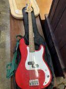 A Squier by Fender P-bass guitar and a Rocket B bass amplifier