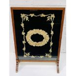 Oak framed fire screen with silk decoration behind perspex.