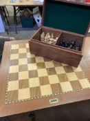 Chess set: chequerboard by Jaques and a full set of wooden pieces in a wooden box