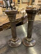 Pair of bronzed columned candlesticks