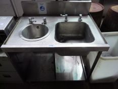 Double hand wash sink with taps and under shelf with splash back