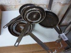 Four frying pans