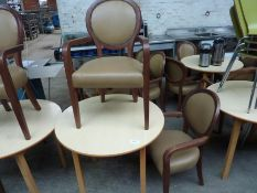 Wooden table with two upholstered chairs