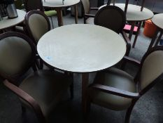 Wooden table with four upholstered chairs