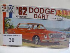 62 Dodge Dart hardtop and a '64 Cadillac de Ville Convertible