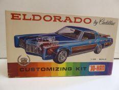 69 Cadillac Eldorado and a 70s Cadillac Coupe De Ville